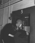 Baltic guard inspects a prisoner